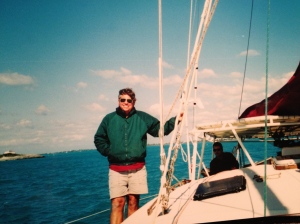 "My father aboard ""Boomerang"" the Apache 45' catamaran that I was raised aboard"